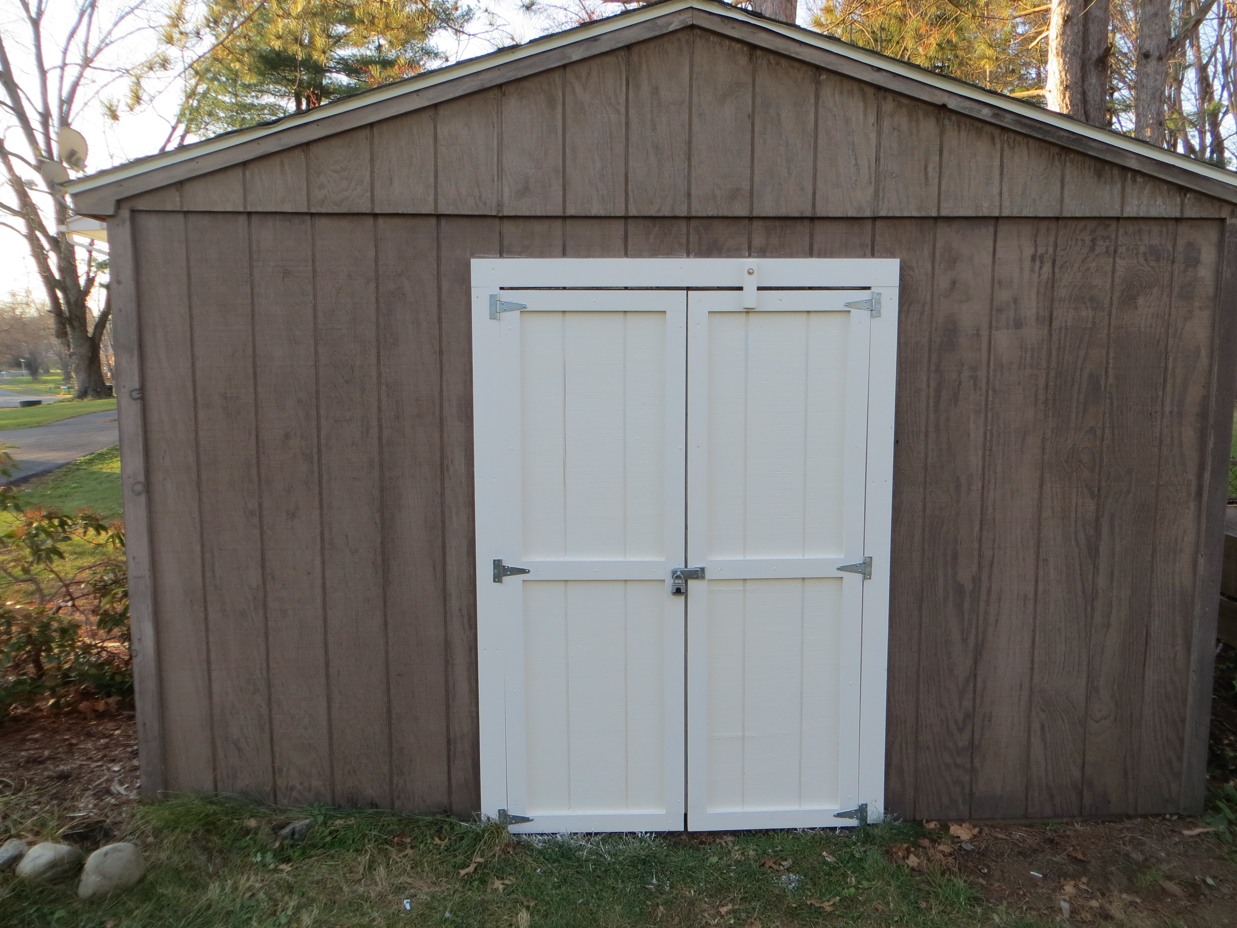 Special note to family Now I know there have been some complaints but opening the shed door it really quite easy if you follow these simple steps. & Most Glorious Shed Door Beautification Project | Happy Valley News Hour